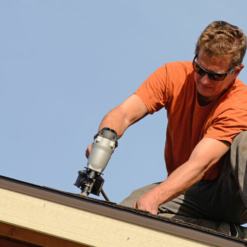 A Roofer Makes a Repair.